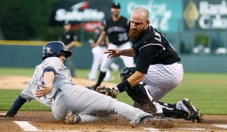 Colorado Rockies catcher Jonathan Lucroy, right, tags out Milwaukee Brewers' Neil Walker as he tries to steal home plate from third base during a double steal in the first inning of a baseball game Saturday, Aug. 19, 2017, in Denver. (AP Photo/David Zalubowski)