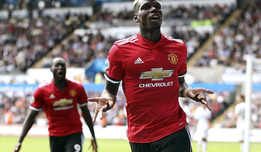 Manchester United's Paul Pogba celebrates scoring his side's third goal, during the English Premier League soccer match between Swansea and Manchester United, at the Liberty Stadium, in Swansea, Wales, Saturday Aug. 19, 2017. (Nick Potts/ PA via AP)
