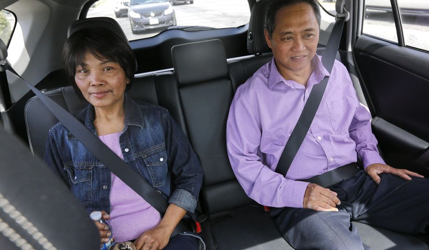 Gregoria Maguigad, left, and her husband sit inside Causey's car. Maguigad was diagnosed in the spring and is undergoing chemotherapy. (Noelle Haro-Gomez /The Tri-City Herald via AP)