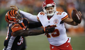 Kansas City Chiefs quarterback Patrick Mahomes (15) stiff-arms Cincinnati Bengals outside linebacker Marquis Flowers (53) during the second half of an NFL preseason football game, Saturday, Aug. 19, 2017, in Cincinnati. (AP Photo/Gary Landers)