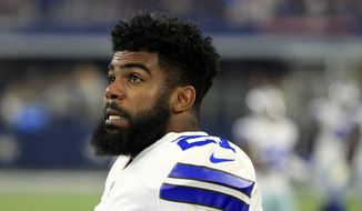 Dallas Cowboys running back Ezekiel Elliott (21) watches play against the Indianapolis Colts from the sideline in the first half of a preseason NFL football game, Saturday, Aug. 19, 2017, in Arlington, Texas. (AP Photo/Ron Jenkins)