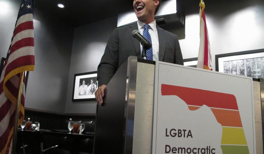 Businessman and gubernatorial candidate Chris King talks to a group of gay and lesbian Democrats in Tallahassee, Fla., on Saturday, Aug. 19, 2017. (AP Photo/Brendan Farrington)