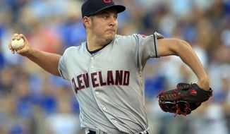Cleveland Indians starting pitcher Trevor Bauer delivers to a Kansas City Royals batter during the first inning of a baseball game at Kauffman Stadium in Kansas City, Mo., Saturday, Aug. 19, 2017. (AP Photo/Orlin Wagner)