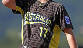 Australia pitcher Tom Stancic collects himself on the mound after allowing a run to score on a wild pitch in second inning of an International pool play baseball game against Japan at the Little League World Series tournament in South Williamsport, Pa., Friday, Aug. 18, 2017. (AP Photo/Gene J. Puskar)
