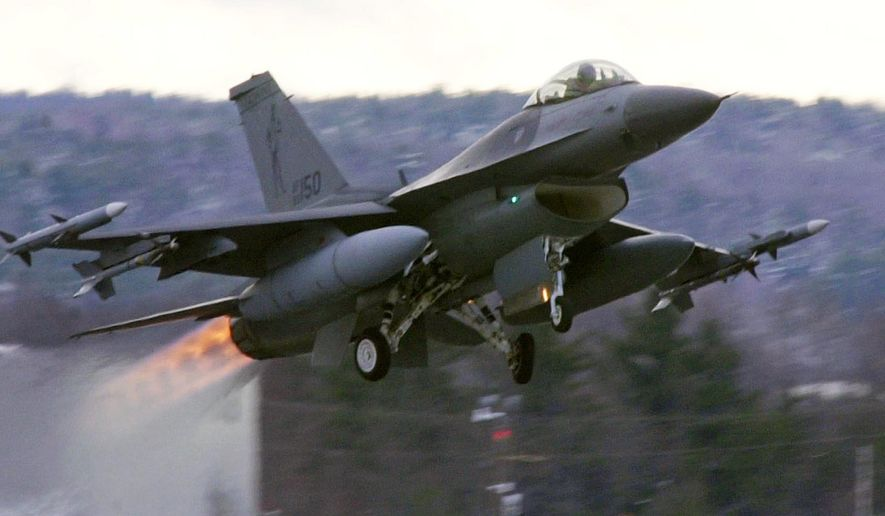 FILE-- In this Dec. 2001 file photograph, an F-16 takes off with afterburners glowing loaded with live Sidewinder missiles from the Air National Guard base in South Burlington, Vt.  A National Guard proposal to expand airspace for fighter jet training flights low over the mountains of western Maine has dragged on for so long that many of the aircraft could be retired around the time the process is completed.  (AP Photo/Toby Talbot)