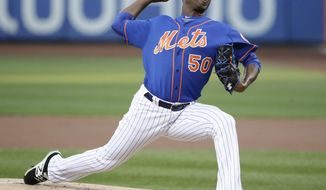 New York Mets' Rafael Montero (50) delivers a pitch during the first inning of a baseball game against the Miami Marlins Saturday, Aug. 19, 2017, in New York. (AP Photo/Frank Franklin II)