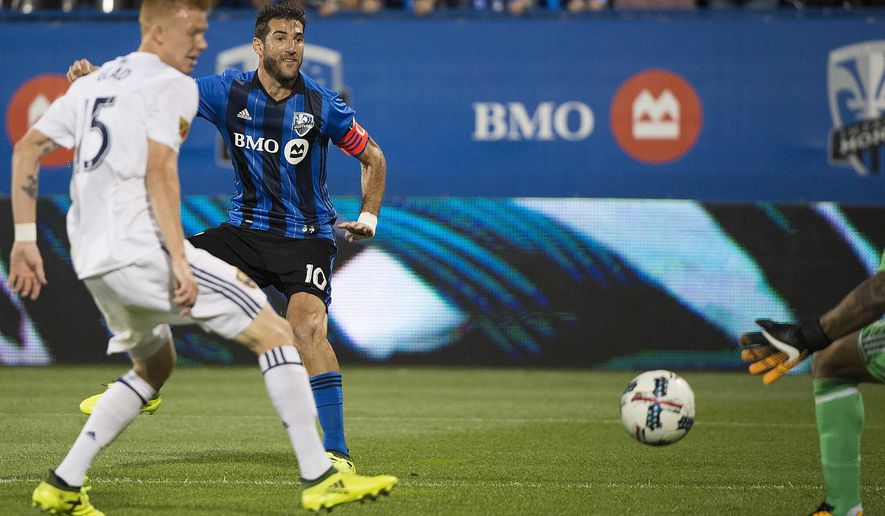 Montreal Impact's Ignacio Piatti (10) scores against Real Salt Lake's goalkeeper Nick Rimando as Justen Glad (15) defends  during the first half of an MLS soccer match in Montreal, Saturday, Aug. 19, 2017. (Graham Hughes/The Canadian Press via AP)