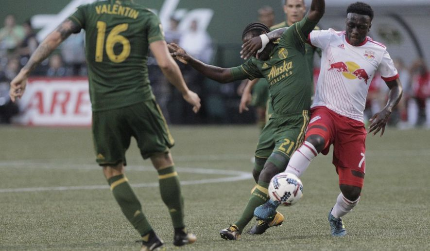 New York Red Bulls' Derrick Etienne Jr. (7) works for the ball against Portland Timbers' Diego Chara (21) during an MLS soccer match in Portland, Ore., Friday, Aug. 18, 2017. (Sean Meagher/The Oregonian via AP)