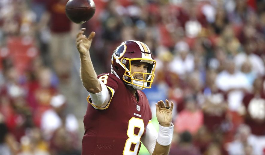 Washington Redskins quarterback Kirk Cousins (8) passes the ball during the first half of an NFL preseason football game against the Green Bay Packers in Landover, Md., Saturday, Aug. 19, 2017. (AP Photo/Alex Brandon)
