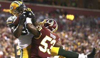 Green Bay Packers tight end Martellus Bennett (80) pulls in a touchdown pass under pressure from Washington Redskins linebacker Zach Brown (53) during the first half of an NFL preseason football game in Landover, Md., Saturday, Aug. 19, 2017. (AP Photo/Mark Tenally)