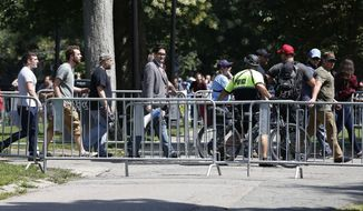 "Organizers depart a ""Free Speech"" rally staged by conservative activists on Boston Common, Saturday, Aug. 19, 2017, in Boston.  One of the planned speakers of a conservative activist rally that appeared to end shortly after it began says the event ""fell apart.""Dozens of rallygoers gathered Saturday on Boston Common, but then left less than an hour after the event was getting underway. Thousands of counterprotesters had also gathered. (AP Photo/Michael Dwyer)"