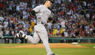New York Yankees' Tyler Austin rounds the bases after his three-run home run against the Boston Red Sox during the second inning of a baseball game at Fenway Park in Boston on Saturday, Aug. 19, 2017. (AP Photo/Winslow Townson)