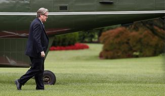 In this May 13, 2017, file photo, Steve Bannon, then-chief White House strategist to President Donald Trump, walks from Marine One on the South Lawn of the White House in Washington. (AP Photo/Carolyn Kaster, File)
