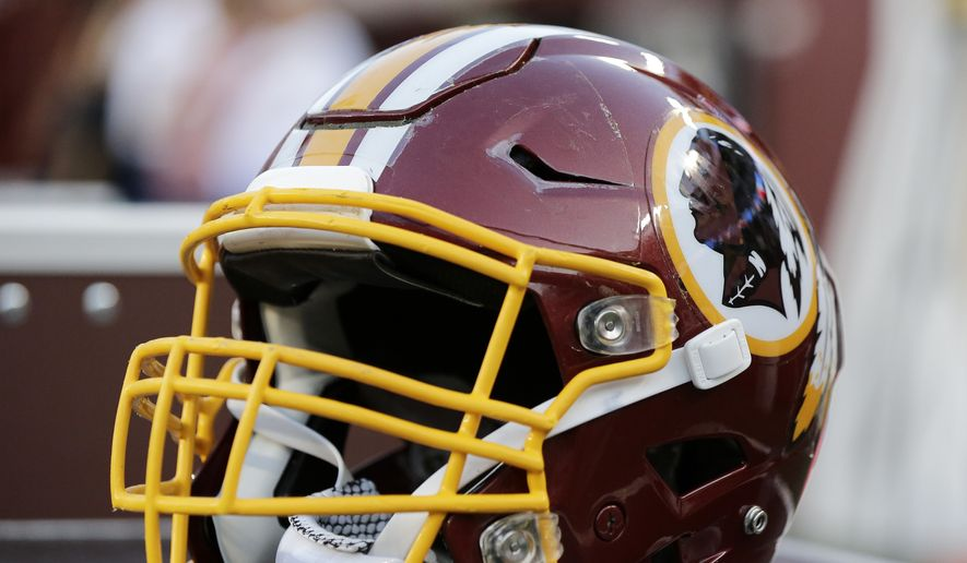 A Washington Redskins helmet sits on the bench prior to a preseason NFL football game Saturday, Aug. 19, 2017, in Landover, Md. (AP Photo/Mark Tenally)  **FILE**