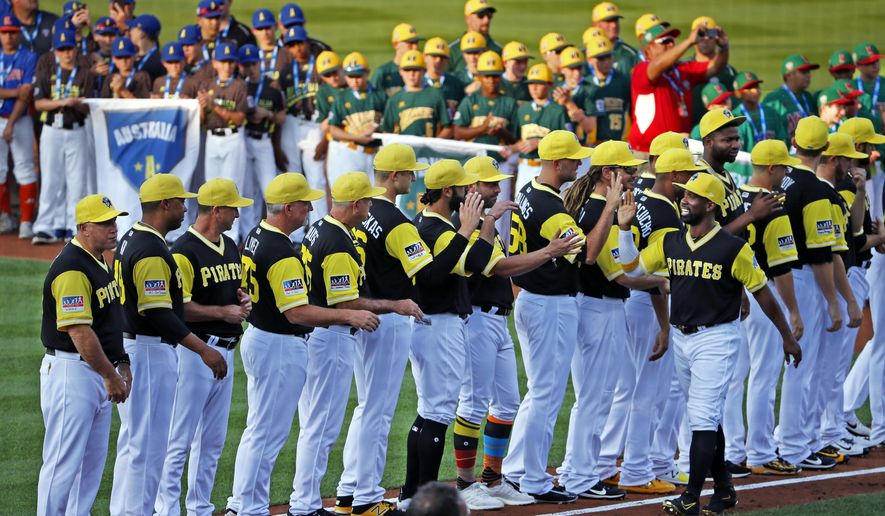 Pittsburgh Pirates' Andrew McCutchen, lower right, is introduced as Little League World Series teams, rear, from around the world line the infield before the Little League Classic baseball game between the Pirates and the St. Louis Cardinals at Bowman Field in Williamsport, Pa., Sunday, Aug. 20, 2017. (AP Photo/Gene J. Puskar)