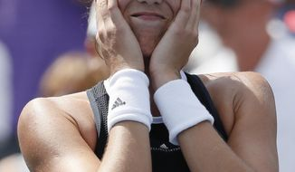 Garbine Muguruza, of Spain, reacts after defeating Simona Halep, of Romania, in the women's singles final at the Western & Southern Open, Sunday, Aug. 20, 2017, in Mason, Ohio. Muguruza won 6-1, 6-0. (AP Photo/John Minchillo)