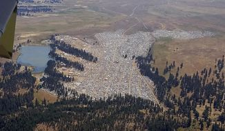 This Saturday, Aug. 19, 2017 photo provided by the Oregon State Police shows the crowd at the Big Summit Eclipse 2017 event near Prineville, Ore. The full solar eclipse will happen Monday, Aug. 21, 2017. (Oregon State Police via AP)