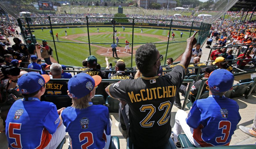 Grosse Pointe, Mich.'s players Matthew Greene (5), Tommy Harris (2), and Branden Campbell (3) sit with Pittsburgh Pirates' Andrew McCutchen (22) in the stands at Lamade Field during a baseball game between Fairfield, Conn., and Lufkin, Texas in United States pool play at the Little League World Series tournament in South Williamsport, Pa., Sunday, Aug. 20, 2017. The Pirates will be playing the St. Louis Cardinals in Bowman Stadium in Williamsport, Pa., on Sunday Night Baseball. (AP Photo/Gene J. Puskar)