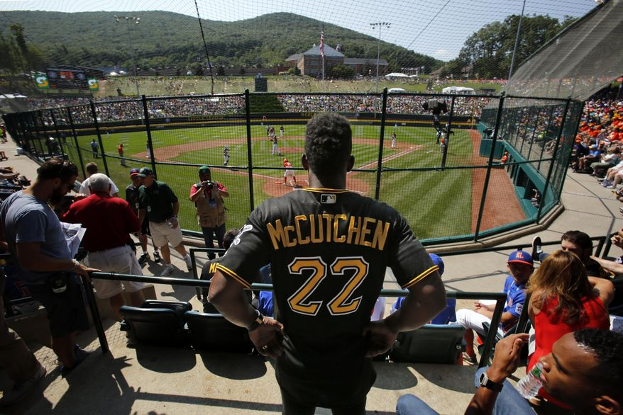 Pittsburgh Pirates' Andrew McCutchen (22) watches from the stands behind home plate at Lamade Field during a baseball game between Fairfield, Conn., and Lufkin, Texas in United States pool play at the Little League World Series tournament in South Williamsport, Pa., Sunday, Aug. 20, 2017. The Pirates will be playing the St. Louis Cardinals in Bowman Stadium in Williamsport, Pa., on Sunday Night Baseball. (AP Photo/Gene J. Puskar)
