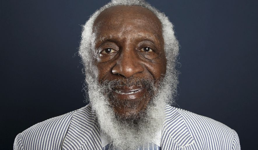 FILE - In this July 21, 2012 file photo, comedian and activist Dick Gregory poses for a portrait during the PBS TCA Press Tour in Beverly Hills, Calif. Gregory, the comedian and activist and who broke racial barriers in the 1960s and used his humor to spread messages of social justice and nutritional health, has died. He was 84. Gregory died late Saturday, Aug. 19, 2017, in Washington, D.C. after being hospitalized for about a week, his son Christian Gregory told The Associated Press. He had suffered a severe bacterial infection. (Photo by Matt Sayles/Invision/AP, File)