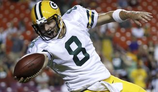 Green Bay Packers quarterback Taysom Hill (8) celebrates as he carries the ball into the end zone for a touchdown during the second half of an NFL preseason football game against the Washington Redskins in Landover, Md., Saturday, Aug. 19, 2017. (AP Photo/Alex Brandon)