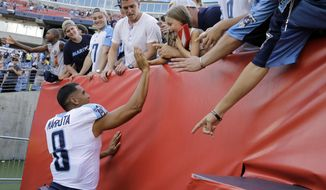 Tennessee Titans quarterback Marcus Mariota slaps hands with fans after the Titans defeated the Carolina Panthers 34-27 in an NFL football preseason game Saturday, Aug. 19, 2017, in Nashville, Tenn. (AP Photo/James Kenney)