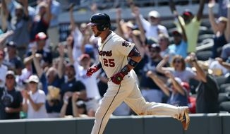 Atlanta Braves' Tyler Flowers rounds the bases after hitting a grand slam in the fifth inning of a baseball game against the Cincinnati Reds Sunday, Aug. 20, 2017, in Atlanta. (AP Photo/John Bazemore)