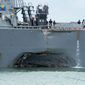 The USS John S. McCain was damaged on its portside during a collision with an oil tanker in the Pacific on Monday in Southeast Asian waters. Ten American sailors are lost at sea. A top U.S. Navy official hasn't yet ruled out that the collision was intentional. (Associated Press)