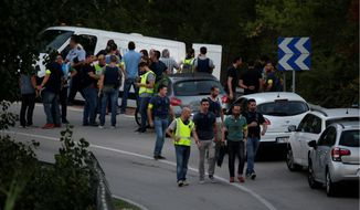 Spanish police Monday shot and killed a man suspected of driving a van into a sidewalk crowd in Barcelona, killing 13. The suspect's death temporarily united Catalonians and Spaniards amid a contentious Catalonian independence movement. (Associated Press)