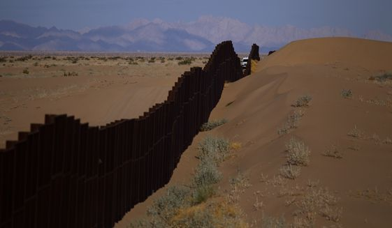 A triple layer of fencing, more Border Patrol agents and bollard-style barriers along the border have reduced illegal crossings from Mexico into Yuma, Arizona, by nearly 90 percent. President Trump is due to visit the border town, considered a monumental success, on Tuesday. (Associated Press)