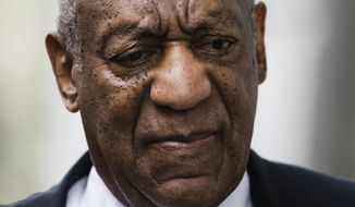FILE - In this June 17, 2017 file photo, Bill Cosby arrives for his sexual assault trial at the Montgomery County Courthouse in Norristown, Pa. Cosby's spokesman announced Monday, Aug. 21, 2017, that Cosby has hired Michael Jackson's former lawyer, Tom Mesereau, to represent him at his November retrial on sexual assault charges in Pennsylvania.(AP Photo/Matt Rourke, File)