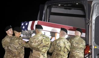 An Army carry team moves a transfer case containing the remains of Staff Sgt. Aaron R. Butler at Dover Air Force Base, Del., Friday, Aug. 18, 2017. According to the Department of Defense, Butler, of Monticello, Utah, died Aug. 16 in Nangarhar province, Afghanistan, of injuries sustained from an improvised explosive device while conducting combat operations. (AP Photo/Steve Ruark)