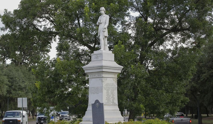 The Richard Dowling statue is shown near the entrance to Hermann Park Monday, Aug. 21, 2017, in Houston. A Houston man was taken into custody on allegations he tried to plant explosives at the statue of Confederate officer Richard Dowling in Hermann Park, according to a high-level law enforcement official familiar with the investigation.(Steve Gonzales/Houston Chronicle via AP)