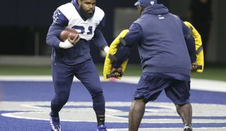 Dallas Cowboys running back Ezekiel Elliott (21) runs a drill during an NFL training camp football practice at the team's headquarters in Frisco, Texas, Monday, Aug. 21, 2017. (AP Photo/LM Otero)