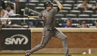 Arizona Diamondbacks A.J. Pollock hits a two-run home run during the tenth inning of a baseball game against the New York Mets on Monday, Aug. 21, 2017, in New York. (AP Photo/Adam Hunger)