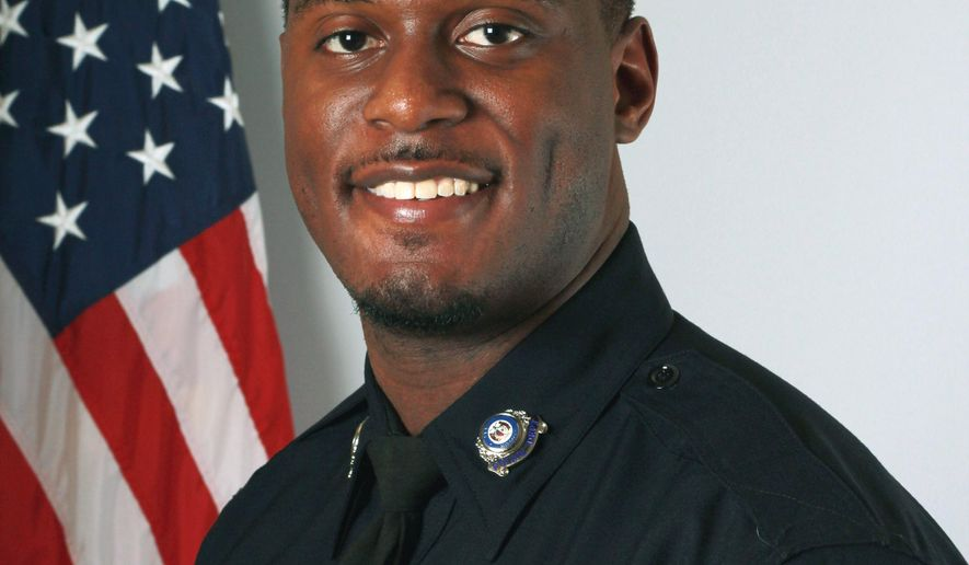 This undated photo provided by the Lees Summit Police Department in Lee's Summit, Mo., shows Officer Thomas Orr, who was fatally shot while off duty Sunday, Aug. 20, 2017, at a restaurant in the Westport bar and entertainment district in Kansas City. Police say the shooting happened after an argument broke out between patrons. (Lee's Summit Police Department via AP)