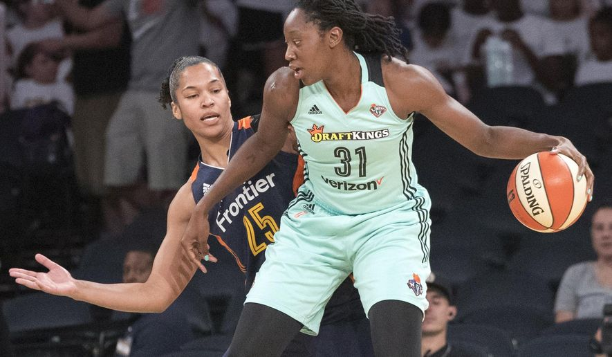 """File-This July 19, 2017, file photo shows New York Liberty center Tina Charles (31) driving to the basket against Connecticut Sun forward Alyssa Thomas (25) during the first half of a WNBA basketball game, at Madison Square Garden in New York.  Charles and her New York Liberty teammates have never shied away from speaking out against social injustices. The Liberty players, along with many others across the WNBA, were vocal last summer in support of the black lives matters movement. On Sunday, Aug. 20. 2017, the Liberty hosted the first """"Unity Game"""" in the WNBA with the Minnesota Lynx. The two teams as well as members of the NYPD and Covenant House locked arms during the playing of the national anthem. (AP Photo/Mary Altaffer, File)"""