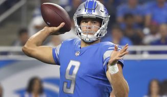In this Aug. 19, 2017 photo, Detroit Lions quarterback Matthew Stafford throws against the New York Jets during a preseason NFL football game in Detroit. Stafford worked with a quarterback coach on his own for the first time in the offseason, but he won't talk about what he's trying to do differently or about his ongoing contract talks with the Lions. (AP Photo/Paul Sancya)