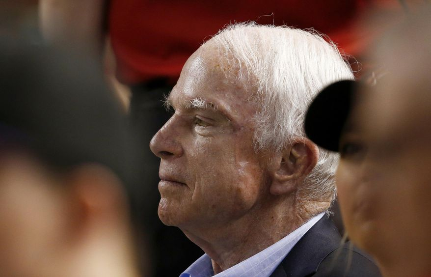 FILE - In this Aug 10, 2017, file photo, Sen. John McCain, R-Ariz., watches a baseball game between the Arizona Diamondbacks and the Los Angeles Dodgers during the first inning in Phoenix. McCain's packed agenda while on break from Congress in his home state of Arizona has hardly been the schedule of a typical brain cancer patient, or even someone about to turn 81. McCain has been undergoing targeted radiation and chemotherapy treatments at the local Mayo Clinic on weekday mornings before going about his day with vigor. (AP Photo/Ross D. Franklin, File)