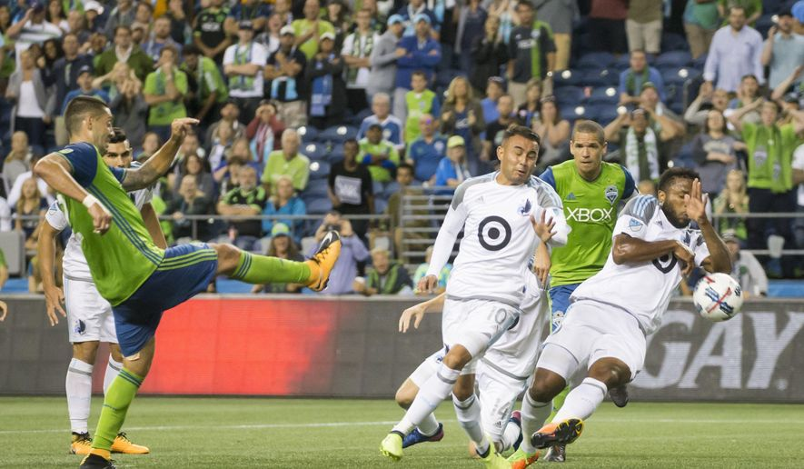 Minnesota United defender Jermaine Taylor commits a handball in the box to award the Sounders a penalty kick in stoppage time, on which Seattle Sounders' Clint Dempsey scored, to give the Sounders a 2-1 win in an MLS soccer match Sunday, Aug. 20, 2017, in Seattle. (Bettina Hansen/The Seattle Times via AP)