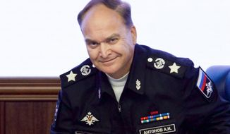 FILE - In this file photo taken on Friday, Oct. 7, 2016, Russian Deputy Defense Minister Anatoly Antonov smiles at a briefing in the Defense Ministry in Moscow, Russia. Antonov, who has gained the reputation of a hawk during his earlier tenure at the Defense Ministry, was named the new Russian ambassador to the United States on Friday. (AP Photo/Ivan Sekretarev, File)
