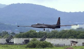 A U.S. Air Force U-2 spy plane takes off on the runway at the Osan U.S. Air Base in Pyeongtaek, South Korea, Monday, Aug. 21, 2017. U.S. and South Korean troops kicked off their annual drills Monday that come after U.S. President Donald Trump and North Korea exchanged warlike rhetoric in the wake of the North's two intercontinental ballistic missile tests last month. (Lee Sang-hack/Yonhap via AP)