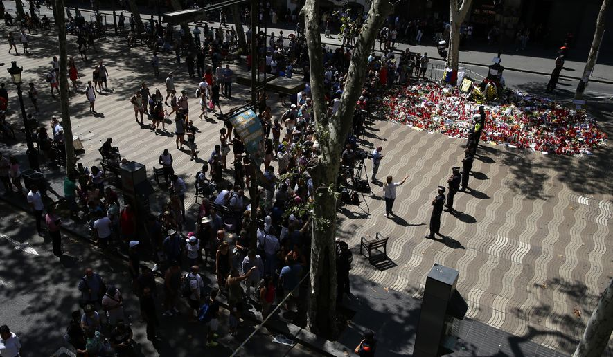 Police officers cordon off the access at Las Ramblas promenade after locating a suspicious backpack in Barcelona, Spain, Monday, Aug. 21, 2017. (AP Photo/Manu Fernandez)