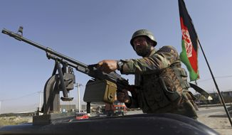 An Afghan National army soldier stands guard a checkpoint on the outskirts of Kabul, Afghanistan, Monday, Aug. 21, 2017. On Monday, President Donald Trump is planning to deliver his first formal address to the nation since taking office as he reveals to the nation his strategy for the war in Afghanistan. (AP Photo/Rahmat Gul)