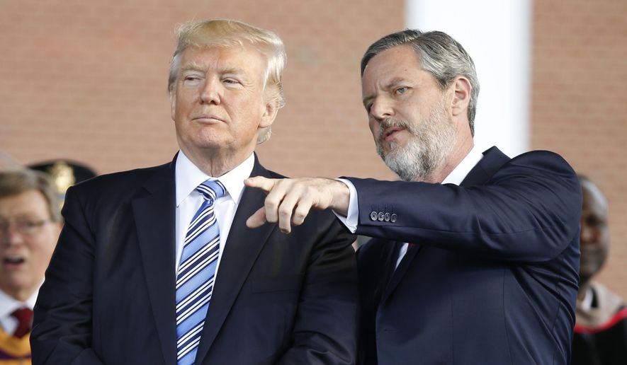 In this file photo taken May 13, 2017, President Donald Trump stands with Liberty University President Jerry Falwell Jr. in Lynchburg, Va. (AP Photo/Steve Helber) ** FILE **