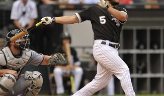 Chicago White Sox's Yolmer Sanchez watches his three-run home run during the fourth inning of game one of a baseball double header against the Minnesota Twins Monday, Aug. 21, 2017, in Chicago. (AP Photo/Paul Beaty)