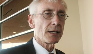FILE - In this March 15, 2017, file photo, Wisconsin State Superintendent Tony Evers talks with reporters in Madison, Wis. Evers plans to announce Monday, Aug. 21, 2017, at an event in Fitchburg, Wis., that he is officially entering the race for Wisconsin governor as a Democrat. (AP Photo/Scott Bauer, File)