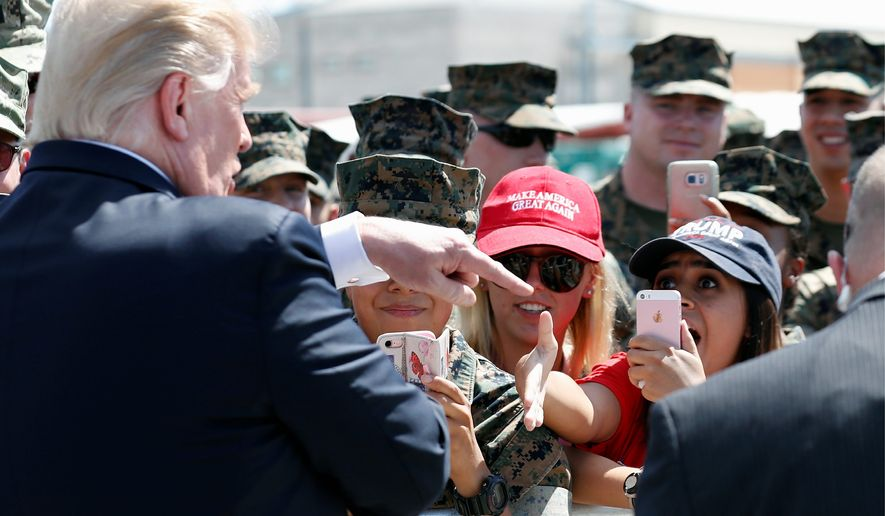 President Trump has been feuding with Sen. Jeff Flake, Arizona Republican, and came to Arizona to rally support for his choice to replace him, Kelli Ward. (Associated Press photographs)
