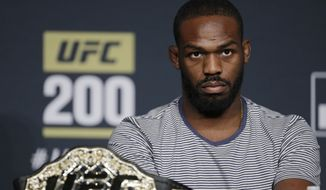 Jon Jones attends a UFC 200 mixed martial arts news conference, Wednesday, July 6, 2016, in Las Vegas. Jones is scheduled to fight Daniel Cormier in a light heavyweight championship fight at UFC 200 on Saturday. (AP Photo/John Locher)