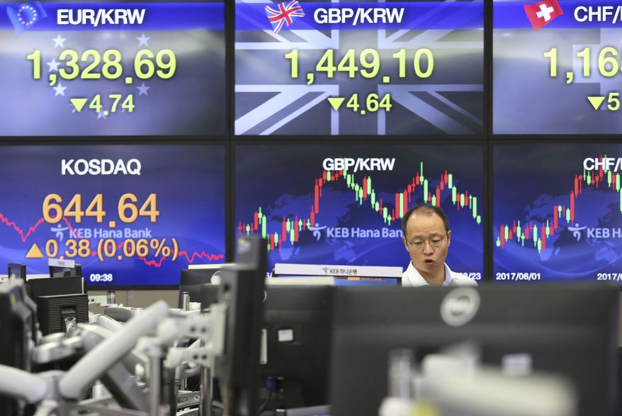A currency trader works at the foreign exchange dealing room of the KEB Hana Bank headquarters in Seoul, South Korea, Wednesday, Aug. 23, 2017. Most Asian markets staged modest gains on Wednesday after overnight gains on Wall Street as geopolitical risks and turmoil at the White House that have dented investor sentiment in the past few weeks abated while investors eyed the annual gathering of central bankers. (AP Photo/Ahn Young-joon)